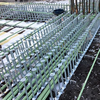 Stud Rail is a double-headed stud anchor (DSA) reinforcement system, typically used for concrete deck-to-column connections