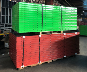Red and green steel and birch plywood handset concrete form panels