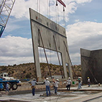 A tilt-up concrete panel is formed on the construction site, lifted into position, and braced until the structure is completed