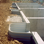 SureBuilt Egress Window Wells anchored to a concrete foundation